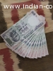 10 notes of hundred rupees in continuous serial order